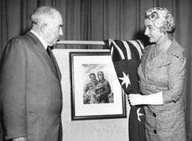 [Miss Florence Fyfe-Smith shows a copy  of a painting of Sir Charles Kingsford-Smith and Captain ...
