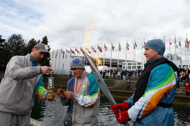 The flame from torchbearer 292 Andrew McLean's torch is married in with the lantern flame for the...