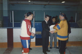 Men shaking hands at Vancouver Oldtimers Ice Hockey Tournament