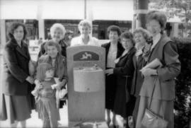 Theresa Galloway and group of women pose with drinking fountain