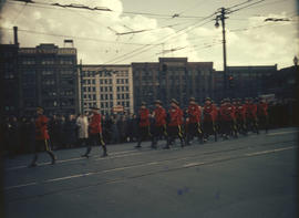 R.C.M.P. marching near Victory Square