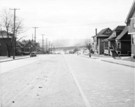 [View of Burrard Street looking south from Harwood at the Kitsilano Railway trestle bridge]