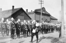 """Calling the Roll"" [Yukon contingent of Canadian soldiers in front of drill hall on Pen..."