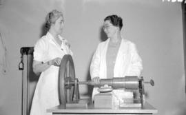 [Miss. Dorothy Atkins and Dr. Alice McDonald, physiotherapist, with exercise equipment]