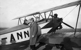 [Mayor L.D. Taylor of Vancouver and Reeve R.M. Grauer with airplane on day of aerial race around ...
