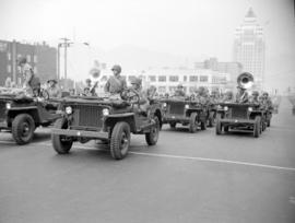 [Military personnel in jeeps in a military parade along Burrard Street]