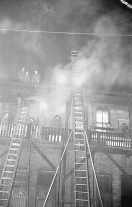 [Firefighters fighting fire at 331 Main Street]