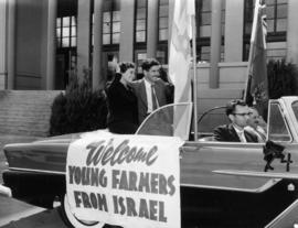 Israeli young farmer guests Edna Shur and Ilan Bender in car by P.N.E. Livestock building