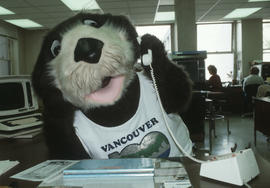 Tillicum on the telephone at an office desk in Vancouver City Hall