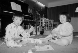 Two young children in a living room