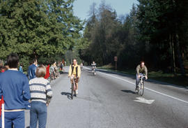 Cyclists in Stanley Park and spectators