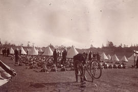 [Soldier repairing a bicycle in camp at Beacon Hill]