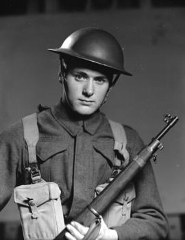 Soldier [holding a rifle]