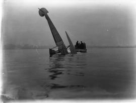 [Seaplane partially submerged in harbour and salvage boat]