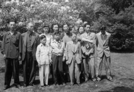 Group portrait of Gum May Yee, Mrs. Chan, Mrs. Chan's three sons, Wilgene Wong, Lillian Wong, Guy...