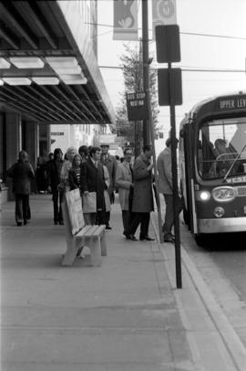 Commuters board a bus near W. Georgia and Seymour Streets