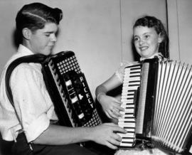 Boy and girl with accordions