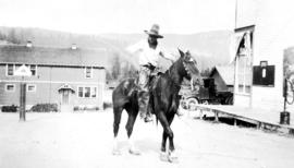 [Board of Trade trip - Williams Lake - Man on horse twirling lasso]