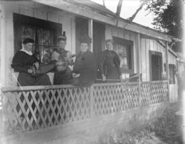 [Four women gathered on porch of James Stark's summer cottage at English Bay]