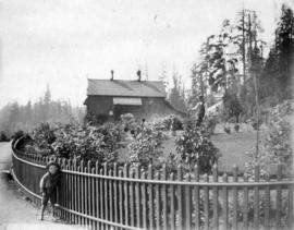 [Henry Avison and his son Henry Stanley Avison outside the Park] Ranger's cottage [at Stanley Park]
