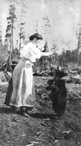 [Mrs. Quiney and bear cub]