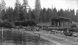 People on beach in front of Lumberman's Arch, Stanley Park