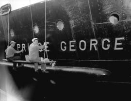 "Workmen polishing [ship's] name ""Prince George"""