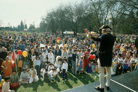 Actor dressed as Captain George Vancouver addressing crowd at Stanley Park