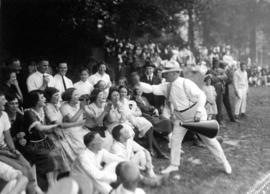 [A man with a megaphone stirs-up the crowd during a sporting activity]