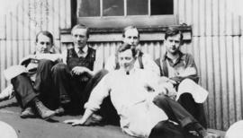 Group of men; W. J. Olsen, second from left