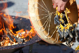 The Flame Creation fire and traditional drum at  Lil'Wat Cultural Centre in Whistler, BC