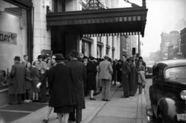 [People waiting outside Hudson's Bay Co. store on Georgia Street during 'Bay Day' ...