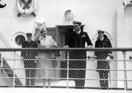 "[King George VI and Queen Elizabeth on the deck of the S.S. ""Prince Robert""]"