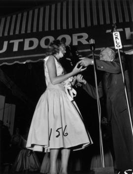 Winner of Miss Vancouver 1955 receiving trophy on Outdoor Theatre stage