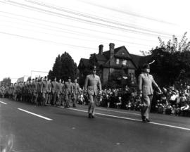 Air force (?) members in P.N.E. parade at Georgia and Thurlow