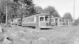 [B.C.E.R. street car bodies in field]