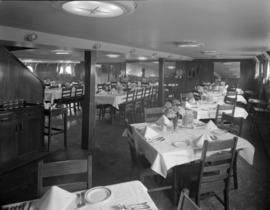 [Interior view of a dining room on board a ship]