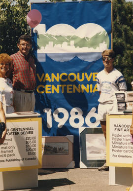 Unidentified woman, Michael Francis and unidentified man posing with Centennial banner
