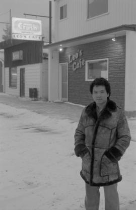 Young man standing at the site of Gordon Yee's café on Centre Street in Naicam, Saskatchewan