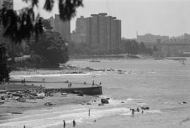 Seawall and swimmers at Third Beach