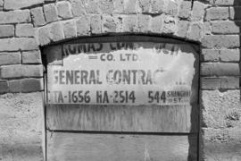 Sign for general contracting company at 544 Shanghai Street