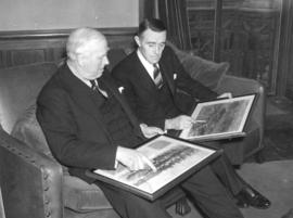 [The Earl of Granville and  Mr. W.A. McAdam studying pictures of Vancouver]