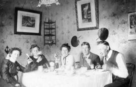[Unidentified men and women eating]