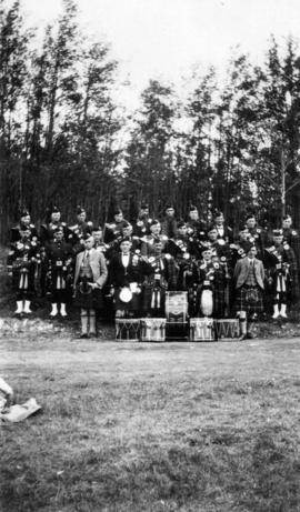 [Group photograph of Scottish band standing outside]
