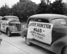 [Posters supporting the Hope Princeton Road attached to the sides of cars]