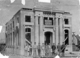 [A group of men in front of the Canadian Imperial Bank of Commerce building under construction 21...
