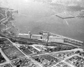 [Aerial photograph of the Alberta Wheat Pool elevators and shipping gallery]