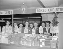 Hudson Bay Company - [clerks behind a display of Christmas cards on the] mezzanine