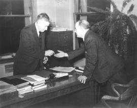 [Mayor Miller returns a key to Major Matthews after the resolution of a dispute regarding the own...