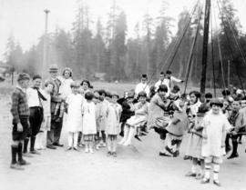 [Group portrait of Mayor L.D. Taylor with children at orphan's picnic hosted by the Vancouver Aut...
